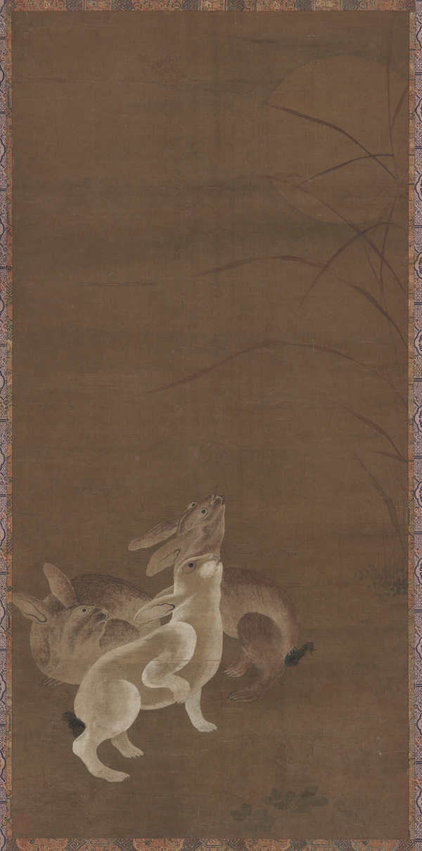 Three hares looking at the moon